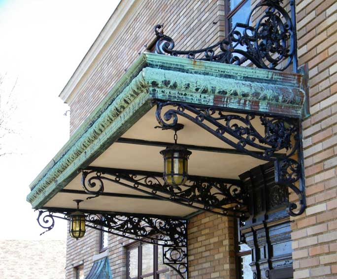 Patinated brass(?) canopy with wrought iron supports & McKinney House