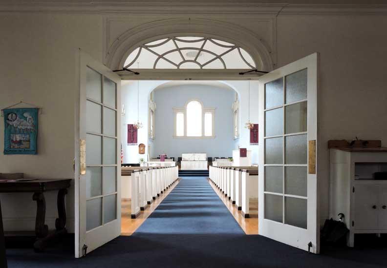 Swinging church doors