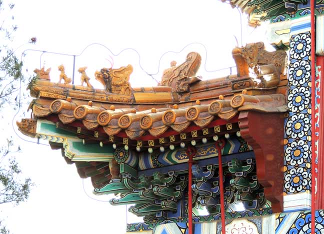 Pillars Painted Red Beams Decorated With Intricate Designs And Chinese Calligraphy The Roof Covered Colored Tiles Complete Mythical Beasts